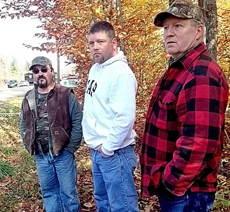 David Stevens, left, said it was unerving that there was a search for Ayla Reynolds' body on Wednesday near his home in Oakland. He was with his brother Wil, center, and their uncle, Paul, near the area being searched.