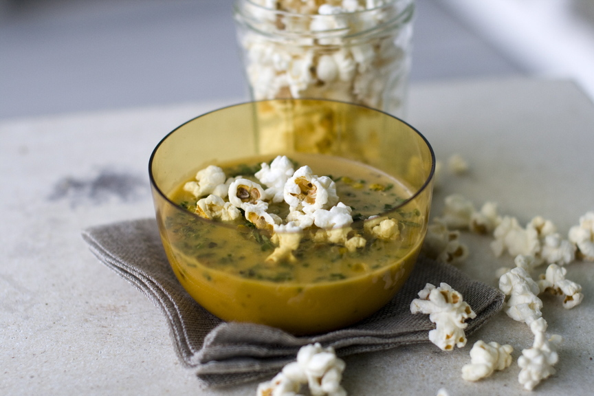Top caramelized onion and squash bisque with popcorn or other tasty options.