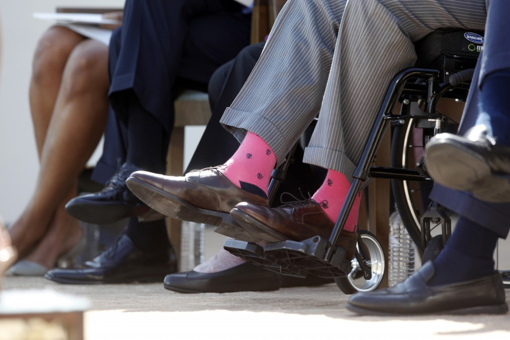 Former President George H.W. Bush wears a pair of his trademark wild socks at the dedication of the George W. Bush presidential library in Dallas in April 25. He's donating a pair of socks to the Roman Catholic Diocese of Portland for a fundraising auction.