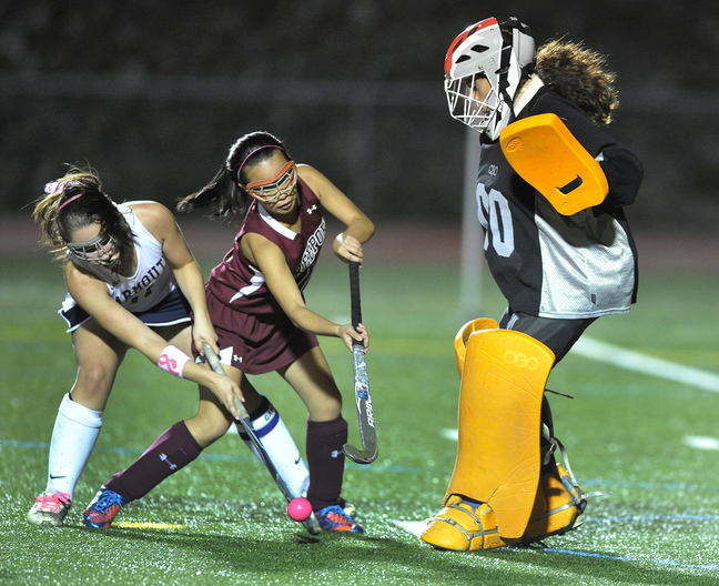 Lily Daggett of Yarmouth, left, attempts to get the rebounded ball past Lee Brown of Freeport and goalie Morgan Karnes. Karnes also stopped this attempt. Yarmouth moved to 9-4-1. Freeport is 5-9.