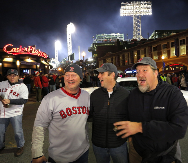 Friends Adam Taylor of Falmouth, Jay Cross of Cape Elizabeth and Dan Lay of Brunswick mingle on Brookline Avenue outside of Fenway Park before Game 6. The Mainers said they came to see history, shorten their bucket lists and simply have a good time.