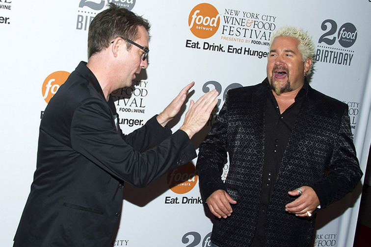 Ted Allen, left, and Guy Fieri attend the Food Network's 20th birthday party on Thursday, Oct. 17, in New York City.