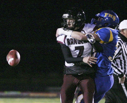Greely's Matt Pisini, left, watches as he fumbles after being hit by Falmouth High School's Tyler Rolfe Friday night.