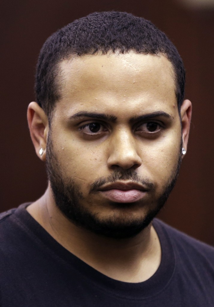 Christopher Cruz appears in criminal court in New York, Wednesday. Cruz was charged Wednesday with reckless driving after prosecutors said he touched off a tense encounter with the driver of an SUV and a throng of other bikers.