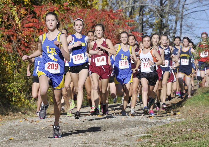 Audrey Blais of Lake Region leads the pack near the start of the girls' race Friday at the Western Maine Conference cross country championships held at St. Joseph's College in Standish.