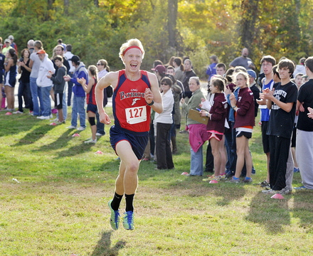 Will Shafer of Gray-New Gloucester shows his excitement as he approaches the finish line to win the boys' race in a time of 16:26.