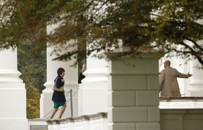Sen. Susan Collins, R-Maine, walks into the White House for a meeting with President Obama and other senators Friday. Collins presented one of several plans for re-opening the government and raising the nation's debt limit.