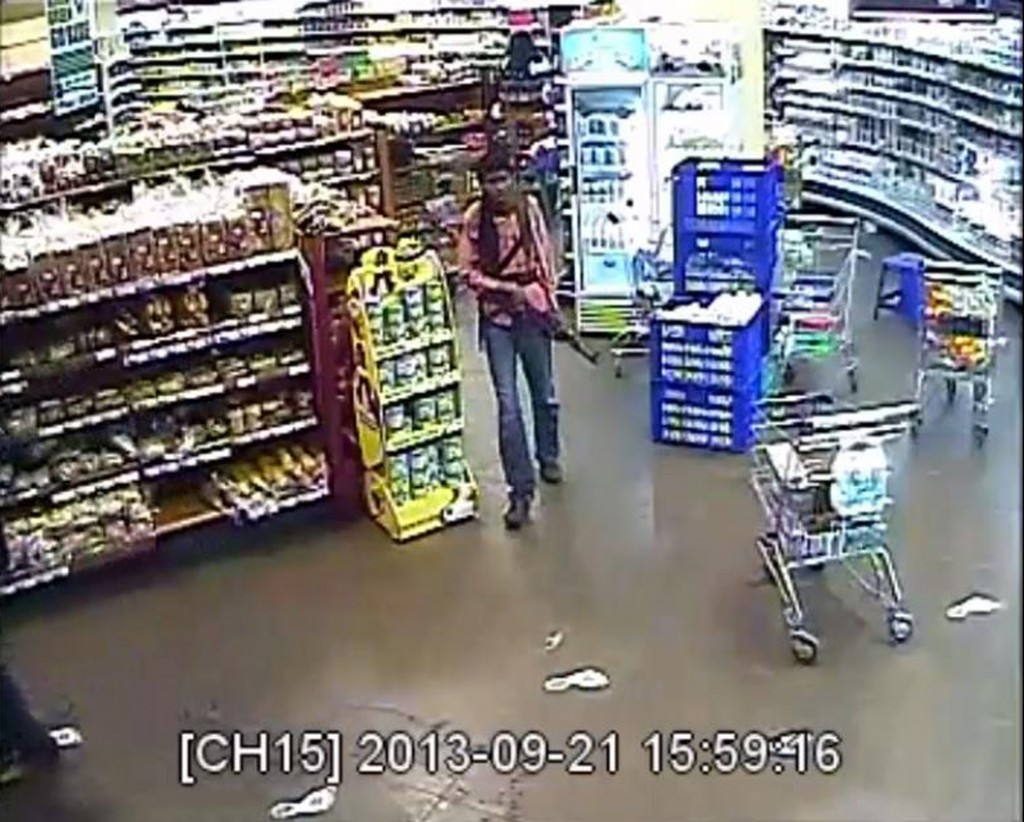 In this photo taken from footage from Citizen TV, via the Kenya Defence Forces and made available Friday, Oct. 4, a man reported to be one of the four armed militants walks in a store at the Westgate Mall, during the four-day-long siege at the Westgate Mall in Nairobi, Kenya which killed more than 60 people last month.