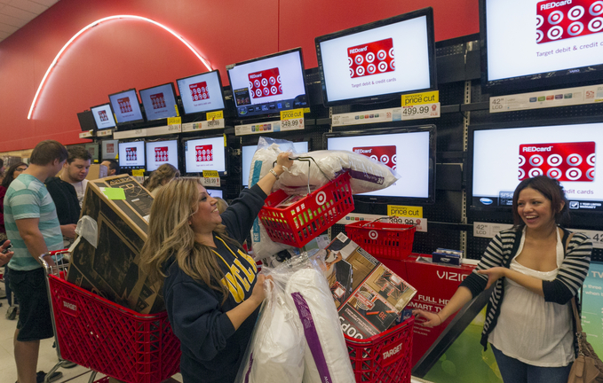 Shopper Roxanna Garcia, center, waits in line to pay for more than $1,000 in gifts at the Target store in Burbank, Calif., last year. Now that the U.S. has averted a default on its debt that could have sent the economy into a tailspin, retailers hope shoppers forget the plan offers only a short reprieve until early next year.