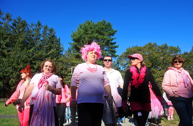 "Jill Brady/Staff Photographer: Tracy Treubig of Portland, center, who is fighting breast cancer and is also 29 weeks pregnant, walks with team ""Pink and Positive,"" made up of family and friends, as they walk to support the fight against breast cancer Sunday, October 20, 2013 at Fort Williams Park in Cape Elizabeth."