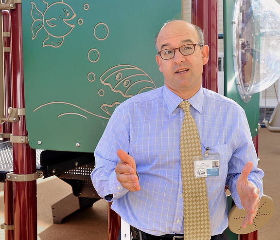 Dr. Matthew Siegel of Spring Harbor Hospital discusses the grant his group received to study autism Thursday, at the new playground designed for autistic and developmentally challenged children.