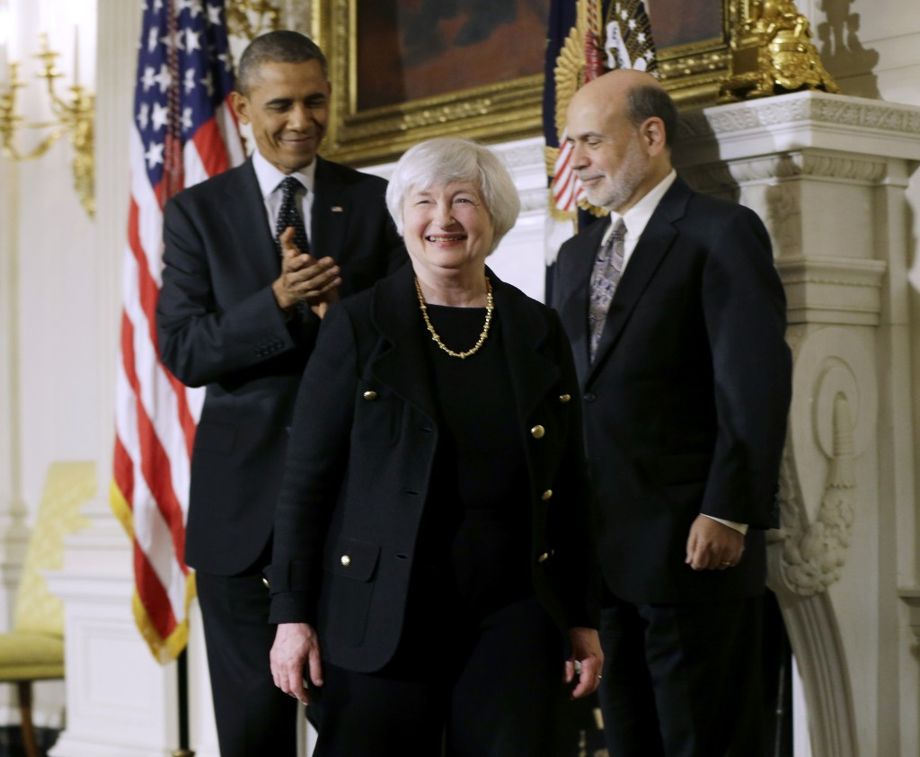 President Barack Obama applauds as he walks out the State Dining Room of the White House in Washington, Wednesday, Oct. 9, 2013, with outgoing Federal Reserve Chairman Ben Bernanke, right, and Janet Yellen, center, his nominee to replace Bernanke.