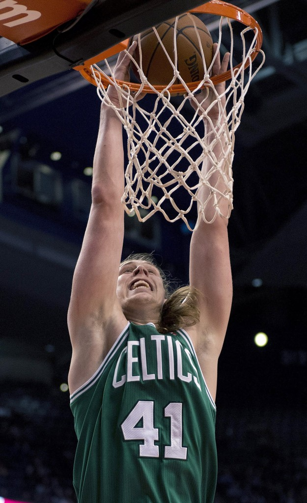 Boston's Kelly Olynyk slam-dunks against the Toronto Raptors during the first half of a preseason game in Toronto on Wednesday.
