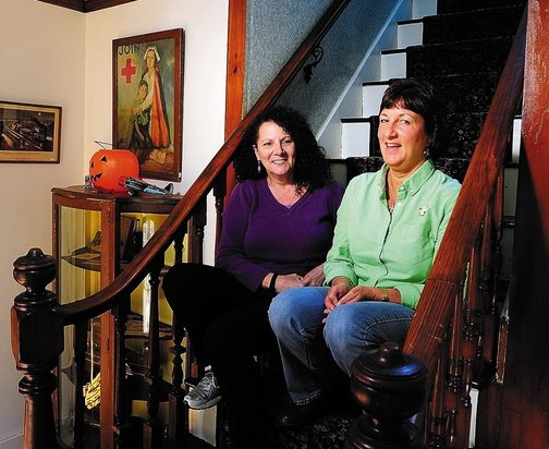 "Annette Parlin, left, a medium/clairvoyant, and Cathy Cook, author of ""Hauntings from Wayne and Beyond,"" talk about the book this week at Cook's home in Wayne. They plan to collaborate with another medium on a sequel."