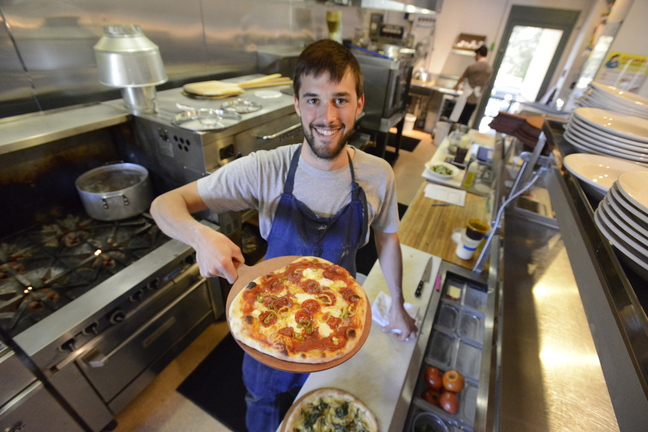 Chef Chad Conley displays a pepperoni with pickled chiles pizza at Gather in Yarmouth.