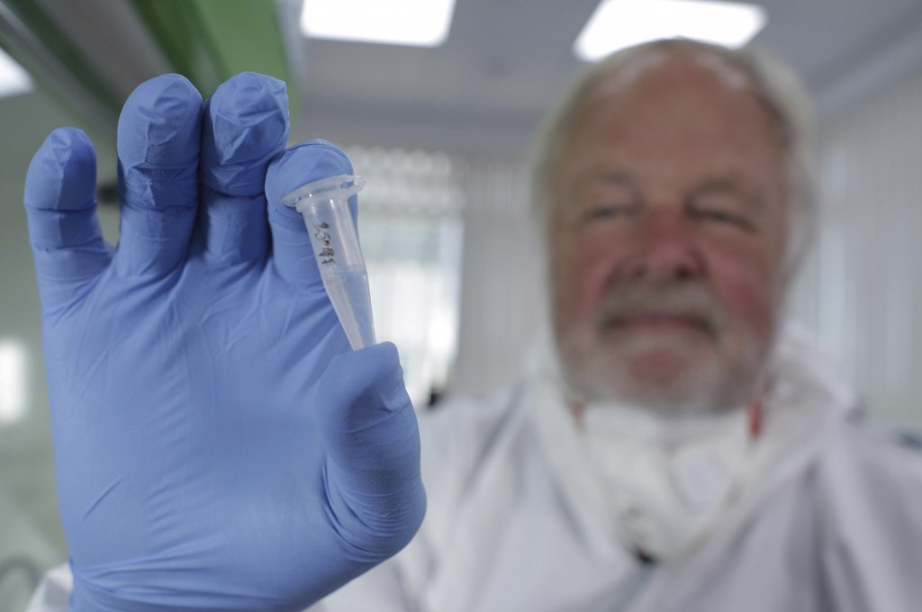Oxford University genetics professor Bryan Sykes poses with a prepared DNA sample taken from hair from a Himalayan animal. His findings, yet to be published, will be aired in a TV show in the UK Sunday.