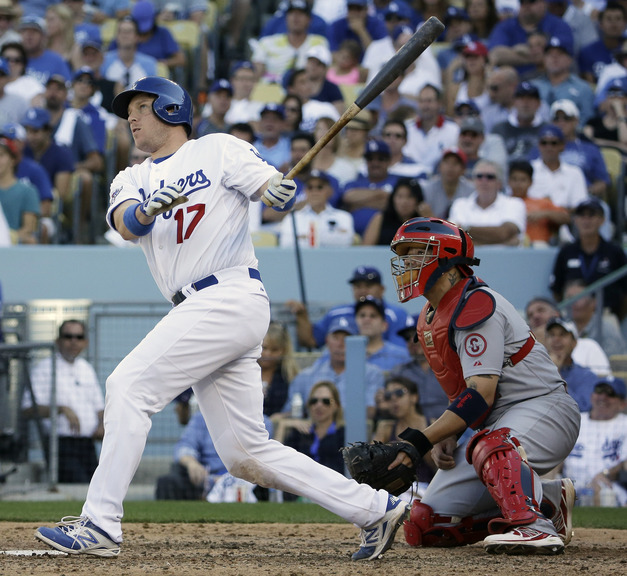 Los Angeles Dodgers' A.J. Ellis hits a home run during the seventh inning of Game 5 of the National League baseball championship series against the St. Louis Cardinals on Wednesday in Los Angeles.