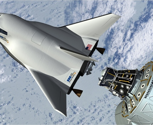 This artist's rendering shows the proposed Dream Chaser spacecraft – made by Sierra Nevada Space Systems – in a simulated docking with the International Space Station.