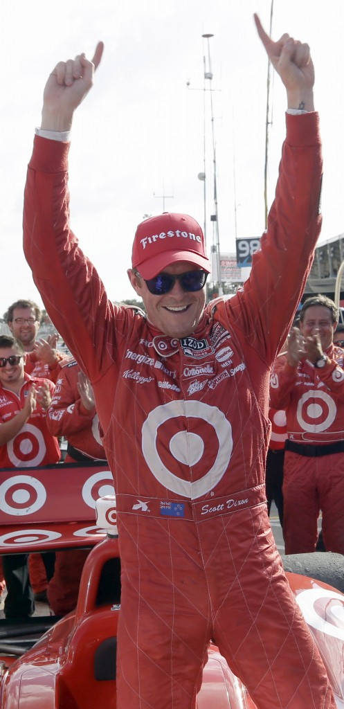 Scott Dixon of New Zealand celebrates after winning the first IndyCar Grand Prix of Houston auto race earlier this month.