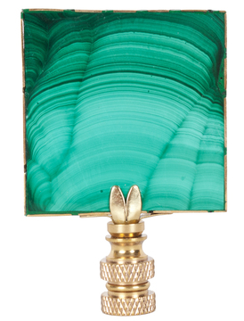 This striking finial from Hillary Thomas is crafted from a sliver of vibrant green and black malachite, adding a distinctive touch to a lamp.