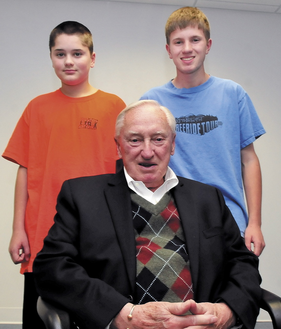 Staff photo by David Leaming GENERATIONS: Red Sox baseball fan Charlie Gaunce is surrounded by his grandsons Daniel, left, and his brother C.J. Gaunce.