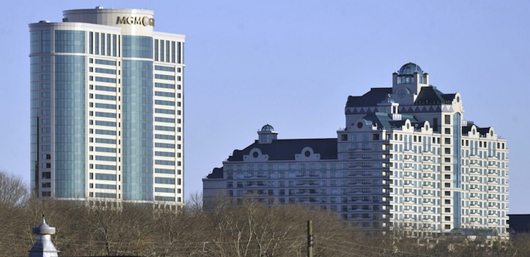 In this November 2010 file photo, the MGM grand tower at Foxwoods Resorts Casino rises over the landscape in Ledyard, Conn. MGM is ending its partnership with the casino as it focuses on its bid to build a casino in Springfield, Mass.