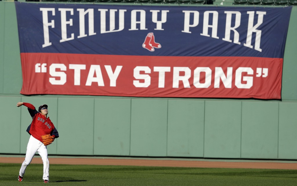 Boston's Koji Uehara, the ALCS MVP, throws during practice Monday at Fenway Park. Game 1 of the World Series with the Cards is Wednesday night.