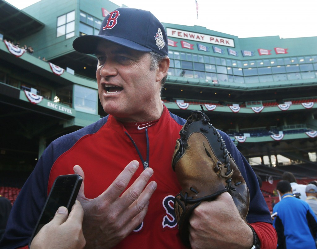 Sox Manager John Farrell speaks to a reporter during World Series practice Monday at Fenway Park. Farrell has not disclosed his lineup for the series, which begins Wednesday.