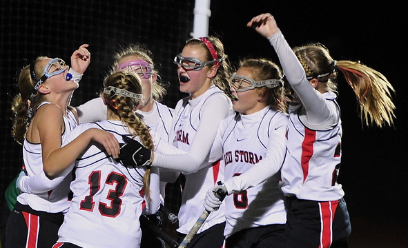 Scarborough players celebrate their second goal of the game Tuesday night on the way to a 6-3 win over Massabesic in the Western Class A field hockey final.
