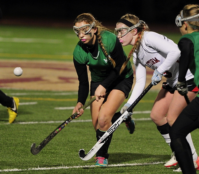 Gordon Chibroski/Staff Photographer. Tuesday, October 29, 2013. Massabesic # 16, Alexis Foglio and Scarborough #12, Maddy Dobecki battle midfield for the ball as Scarborough plays Massabesic in Maine Western A Fieldhockey Final at Thornton Academy. 297066