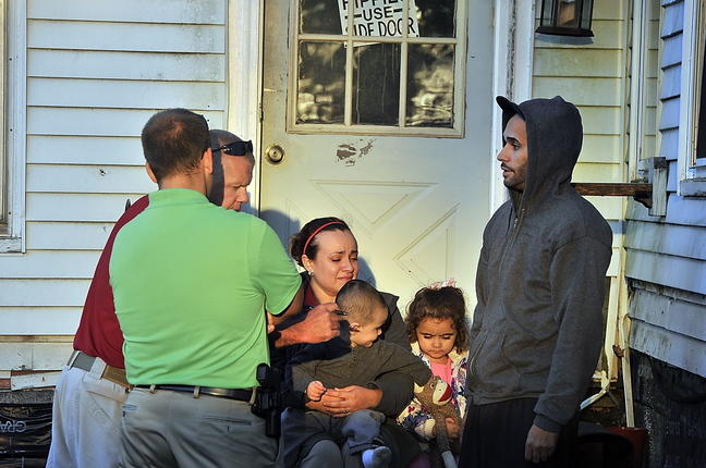 A fire at the Itsa Good Motel on Route 1 in Scarborough on Tuesday caused many to be driven from their rooms. The fire started in the room where Alex Pagen, right, and Monique Mills stayed with their children, Jake and Mia. Scarborough investigators John Gill, left, and Garrett Strout interviewed them after they returned and found they lost everything they owned.