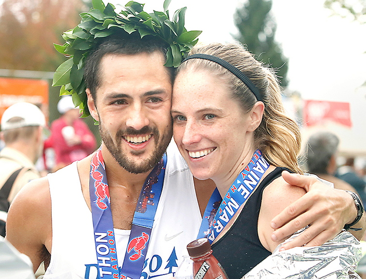 Tim Greenway/Staff Photographer Rob Gomez of Saco receives a hug from his girlfriend, Breagh MacAulay, after winning the Maine Marathon Sunday in a time of 2 hours, 24 minutes and 21 seconds in Portland.