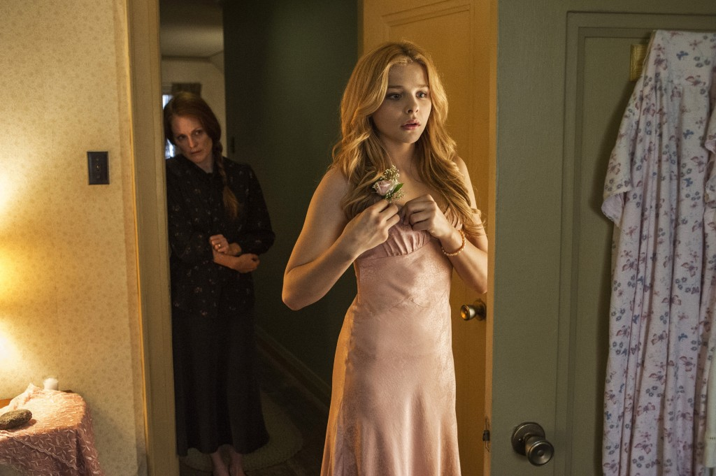 "Chloe Grace Moretz, with Julianne Moore, rear, in a scene from, ""Carrie."""