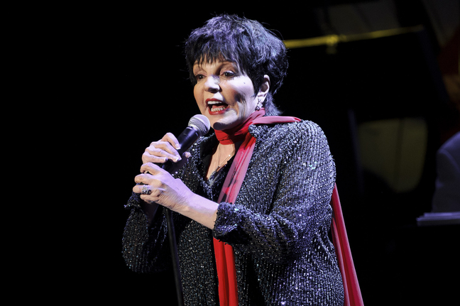 FILE - In this March 1, 2013 file photo, U.S singer Liza Minnelli performs at the Royal Festival Hall in London. A spokesman for the 67-year-old entertainer said she performed with a broken wrist at a benefit concert Monday night, Oct. 14, 2013, in New York. Minnelli broke her wrist in three places while rehearsing at home Sunday night. (Photo by Jonathan Short/Invision/AP, file)