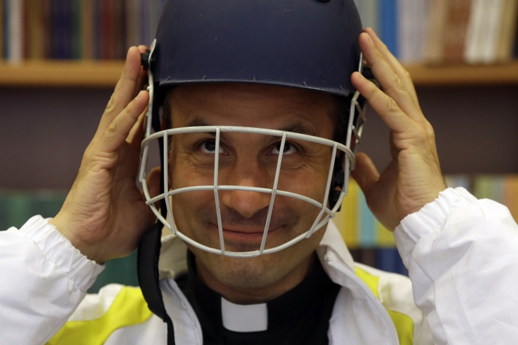 AP Photo/Monsignor Sanchez de Toca y Alameda, undersecretary of the Pontifical Council for Culture, wears a cricket helmet during the presentation of the Vatican cricket club at the Vatican.