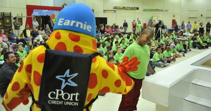 "cPort Credit Union mascot's ""Earnie"" participates in a Riverton Elementary School scholarship awards ceremony in May 2011. Maine credit unions got off to a strong start in 2013, posting new records for the first six months."
