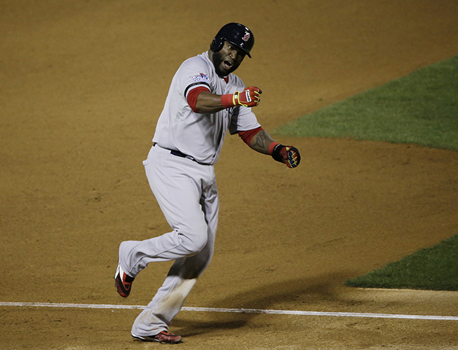 Boston Red Sox David Ortiz celebrates Jonny Gomes' three run home run off of St. Louis Cardinals relief pitcher Seth Maness as he scores during the sixth inning of Game 4 of the World Series Sunday in St. Louis.