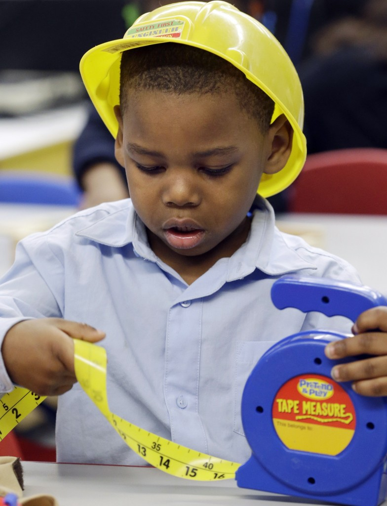 Laneer Reed-Fryer works on a construction-themed project during a prekindergarten class at a public school in Buffalo, N.Y., in March. A state-federal proposal to expand access to early learning programs could lead to 6,700 more high school graduates in Maine, a reader says.