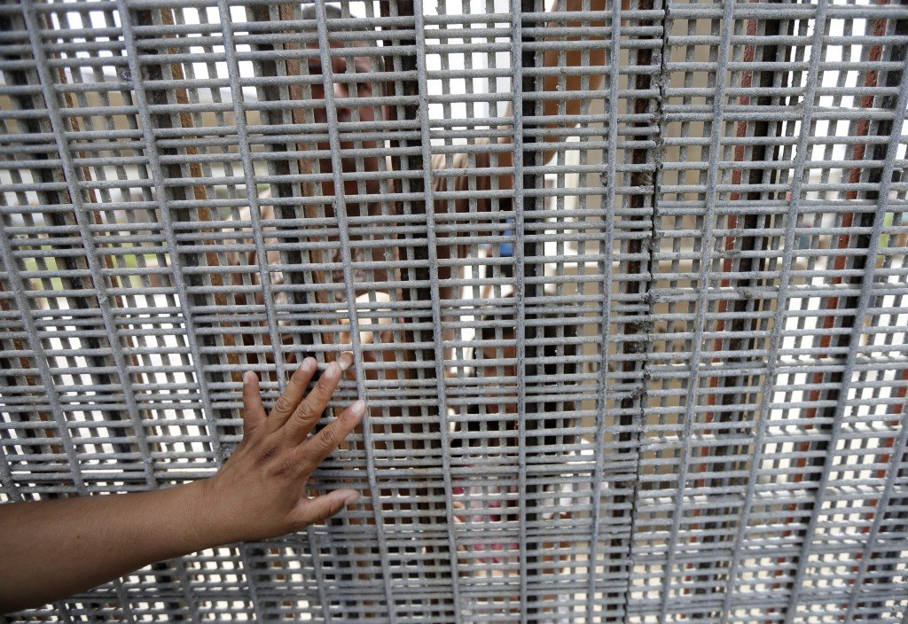 Marta Lopez, left, touches the finger of her daughter Alondra Lopez, 8, as they stand separated by a fence between Tijuana, Mexico, and San Diego during a Sunday Mass celebration. The best way to see the border without crossing it is at Border Field State Park, which is at the farthest southwest corner of the United States.
