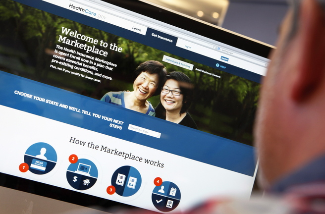 A man reviews the Affordable Care Act signup page on the HealthCare.gov site in this photo illustration. Requiring every citizen to help defray the cost of health care by buying insurance is a way to spread out the cost of a service we all use.