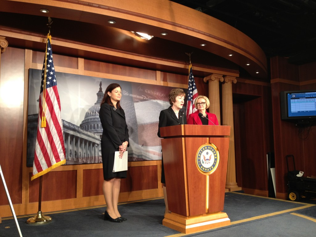 Republican Sens. Susan Collins of Maine, center, and Kelly Ayotte of New Hampshire, left, and Democratic Sen. Claire McCaskill of Missouri speak to reporters Wednesday about legislation they are co-sponsoring that would increase the frequency of background checks on individuals who already hold security clearances.