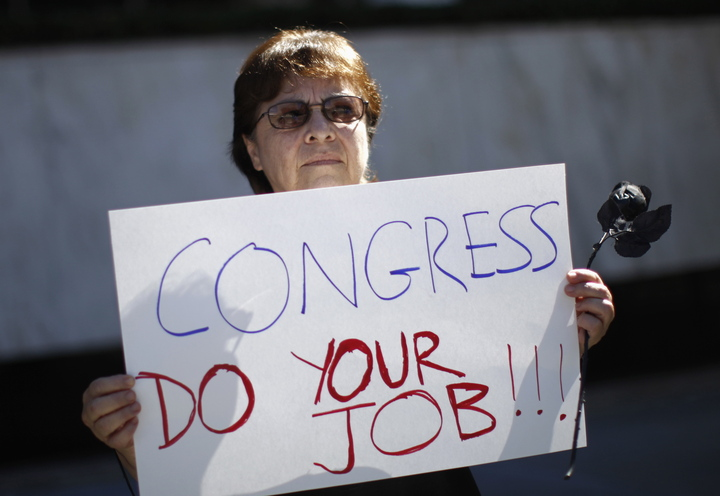 Marcia Noboa, 65, angered over the government shutdown and potential cuts to Social Security and Medicare, protests Wednesday at the Federal Building in Los Angeles, Calif.