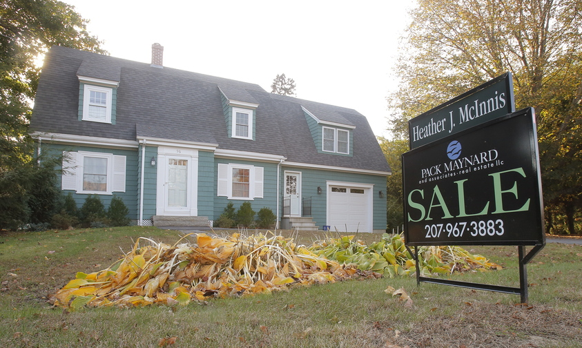 A for sale sign is posted in front of a home on Fletcher Street in Kennebunk. Maine home sales jumped 24.59 percent in September 2013 over September 2012, doubling the pace seen nationally.