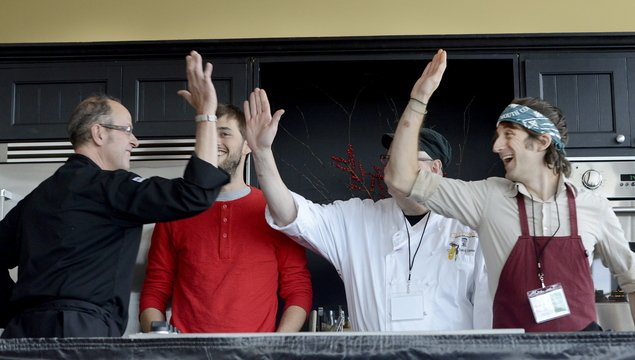 Chef Kerry Altiero, left, from Cafe Miranda in Rockland, gets high-fives after winning the Top of the Crop: Maine's Best Farm to Table Restaurant competition at Ocean Gateway in Portland on Friday. Joining Altiero in the competition were chefs Chad Conley, Rich Hanson and David Levi.