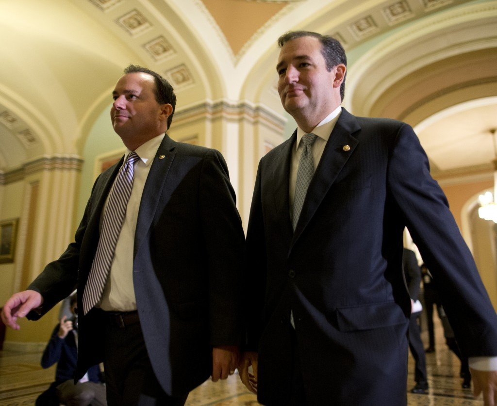 Sens. Mike Lee, R-Utah, left, and Ted Cruz, R-Texas, walk to the Senate floor on Wednesday to vote on a bill that raised the debt ceiling and reopened the federal government.