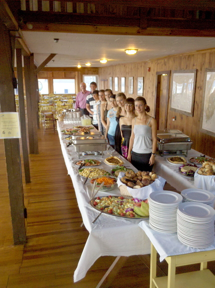 Staff members at the Linekin Bay Resort line up behind the buffet, which was expanded this year to include vegan and gluten-free items.