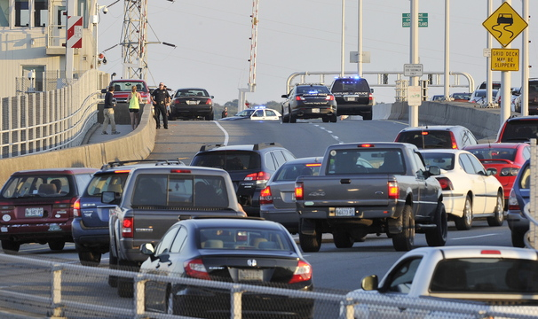 John Ewing/Staff Photographer Police respond to reports of a person threatening to jump from the Casco Bay Bridge on Wednesday evening, Oct. 2, 2013. Traffic was allowed to cross the bridge toward South Portland, but was blocked in the Portland lanes at the height of rush hour.