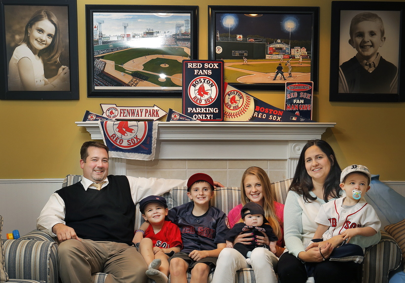 Saco residents Isabel and Jeff Cochrane are big fans of baseball and the Red Sox, as evidenced by their memorabilia and the names they gave many of their children. Above are, from left: dad Jeff; sons Fenway Parke, 3, Jackson, 11, and Pedroia Wakefield, 2 months; daughter Cassidy, 15; son Griffey Junior, 19 months; and mom Isabel.