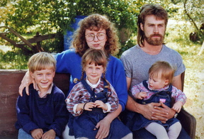 The Mosher siblings, from left, Isaiah, Morgan and Sydney, pose for a family portrait with their parents, Martha and Christopher, more than a decade before their father committed suicide.