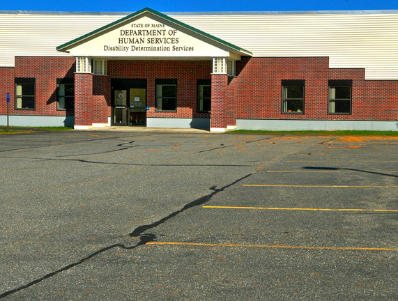 The parking lot in front of the Disability Determination Services office in Winthrop sits empty Tuesday after 52 federally funded workers were temporarily laid off and the office was closed.
